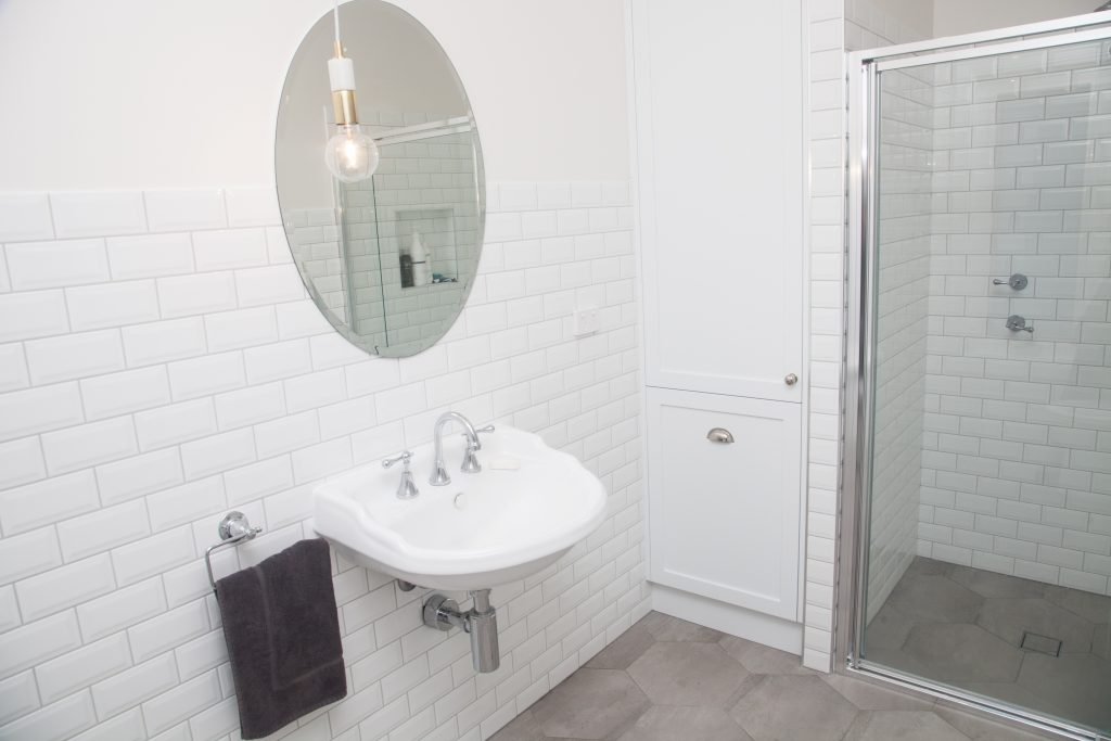 A clean, minimalist look make this bathroom something different. Clever use of built in storage allows for an open and uncluttered look in this bathroom.