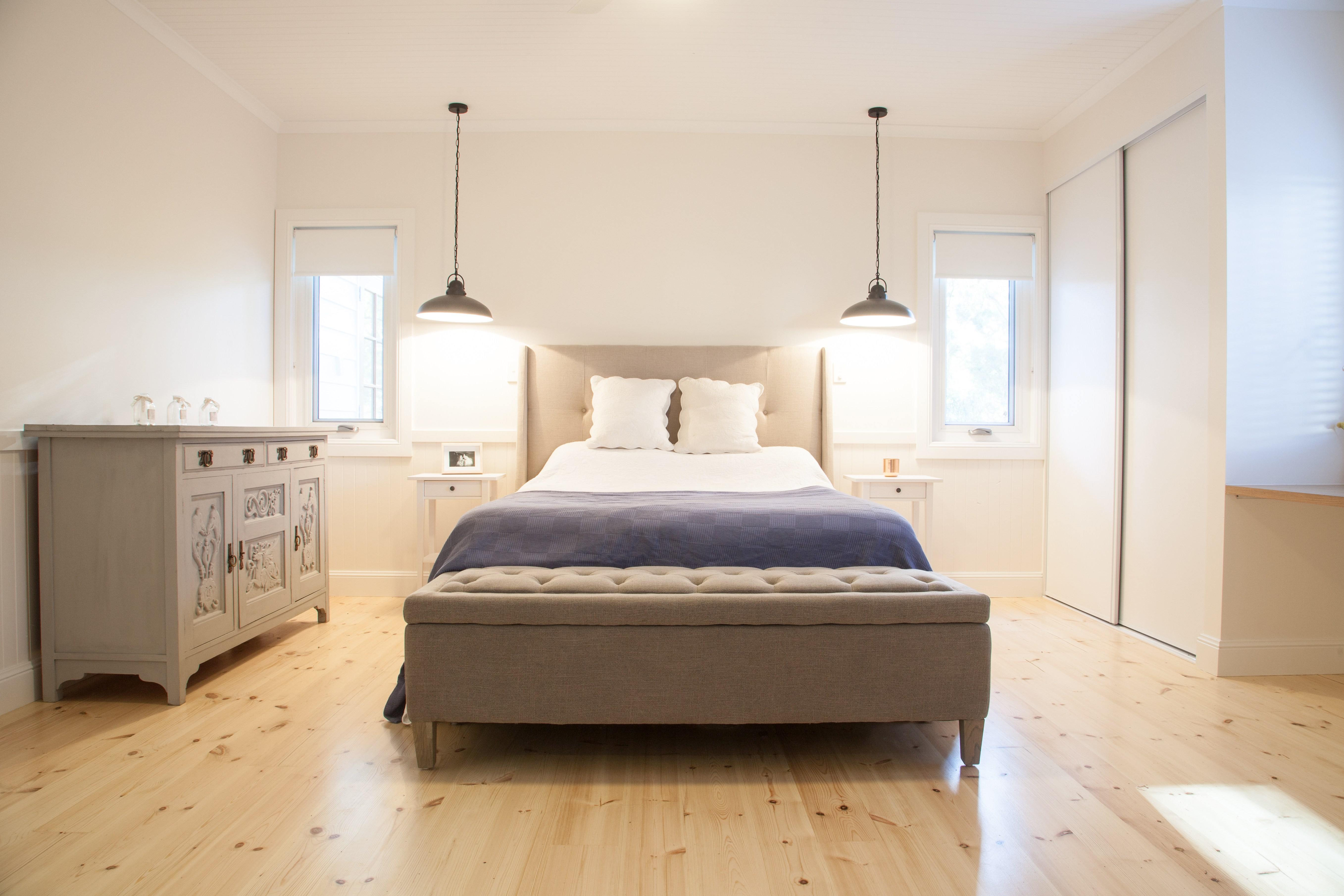 Modern and stylish master bedroom with polished floors by Shire Homes, Balhannah